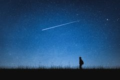 Free Silhouette Of Traveler Standing On Mountain And Night Sky With Stars. Space Background. Stock Image - 133906181