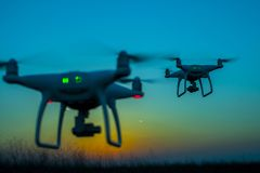 Free Silhouette Of Two Drones In The Sky Stock Images - 101954994