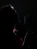Silhouette Of Woman Singing. Royalty Free Stock Photo