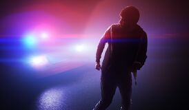 Free Silhouette Of Young Man - Thief Escaping From Police Car At Night. Stock Photo - 169878670