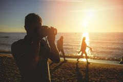 Free Silhouette Of Young Photographer On The Beach Stock Image - 159480871