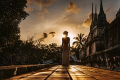 Free Silhouette Of Young Woman Walking At Ancient Temple At Sunset Royalty Free Stock Photography - 183477137