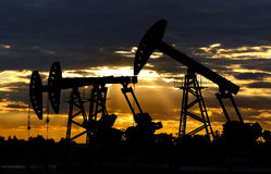 Silhouette of the oil equipment Royalty Free Stock Photography