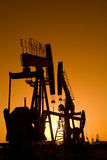 Silhouette of oil pump Royalty Free Stock Photo