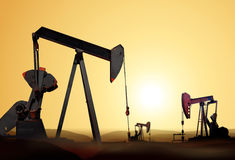 Silhouette of oil pump Stock Photos