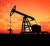 Silhouette oil pump Stock Photos