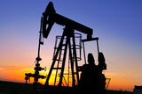 Silhouette of oil pump jacks Stock Photos
