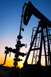 Silhouette of oil pump jacks Stock Photo