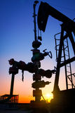 Silhouette of oil pump jacks Royalty Free Stock Images
