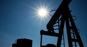 Silhouette of oil pump jacks in operation stock video footage