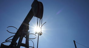 Silhouette of oil pump jacks in operation stock video