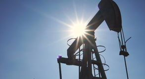 Silhouette of oil pump jacks in operation stock footage