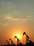 silhouette of oil pump oil rig machine for petroleum energy indu Royalty Free Stock Photos