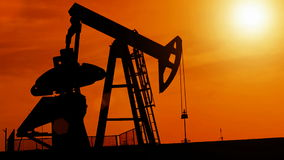 Silhouette of oil pump Royalty Free Stock Images