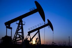 Silhouette of oil pumpjack Stock Photo