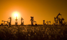 Silhouette of oil pumpjacks Stock Photography