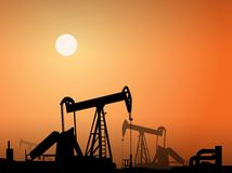 Silhouette of oil pumps Stock Images
