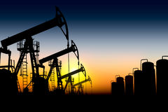 Silhouette oil pumps. Silhouettes of oil pumps placed one after another against the sunset Stock Photo