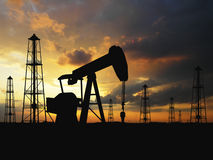 Silhouette  oil pumps. Oil Pumps over orange sky Royalty Free Stock Photography