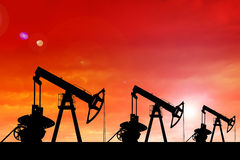 Silhouette of oil pumps at sunset. Stock Photo