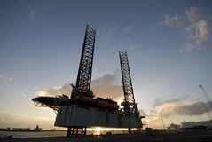 Silhouette of a oil rig royalty free stock photo