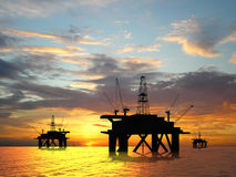 Silhouette oil rig. Oil rig silhouette over orange sky Stock Photography