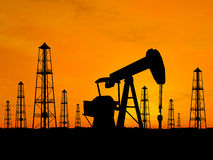 Silhouette oil rigs and pumps Royalty Free Stock Photography