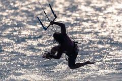 A silhouette ok a kitesurfer in Tarifa, Spain. stock photography
