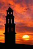 Silhouette of old church in front of beautiful sun. Set sky and clouds in old Jaffa port in Israel Royalty Free Stock Photo