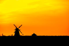 Silhouette of an old historic windmill at sunset Royalty Free Stock Images