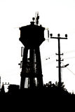 The silhouette of an old water tank Royalty Free Stock Photo