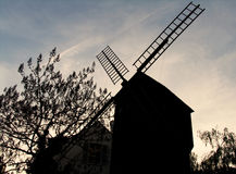 Silhouette of old windmill. From Montmartre in the sunset light Stock Images