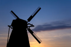 Silhouette of an old windmill. On a background of sunset Royalty Free Stock Photography