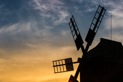 Silhouette of an old windmill against evening sky Royalty Free Stock Photo