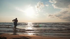 Silhouette old woman lady is standing on the beach and sea with happy life after retirement. Travel and retirement. Fashion and beauty, active elderly people stock footage