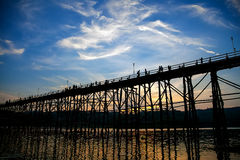 The silhouette of the old wooden bridge in Sangklaburi Stock Images