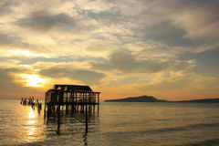 Silhouette of old wooden jetty at sunrise, Koh Rong island, Camb Royalty Free Stock Photography