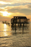 Silhouette of old wooden jetty at sunrise, Koh Rong island, Camb Royalty Free Stock Images