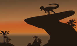 Silhouette of one allosaurus in cliff Royalty Free Stock Photos