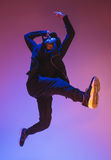 The silhouette of one hip hop male break dancer dancing on colorful background Stock Photography
