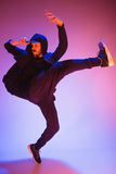 The silhouette of one hip hop male break dancer dancing on colorful background Stock Image