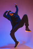 The silhouette of one hip hop male break dancer dancing on colorful background Royalty Free Stock Image