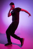 The silhouette of one hip hop male break dancer dancing on colorful background Royalty Free Stock Photography