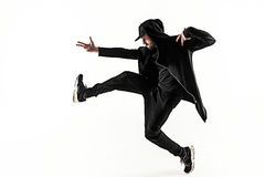 The silhouette of one hip hop male break dancer dancing on white background Stock Photos
