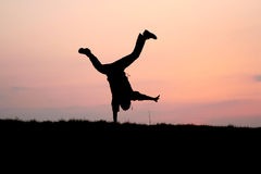 Silhouette of one man jumping Stock Photography
