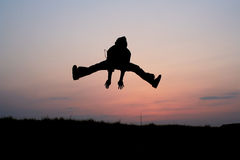 Silhouette of one man jumping Stock Photos