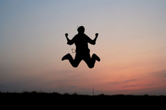 Silhouette of one man jumping Stock Image