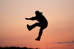Silhouette of one man jumping Royalty Free Stock Photography