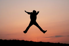 Silhouette of one man jumping Stock Photo