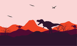 Silhouette of one T-Rex in hill Stock Photography